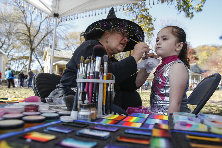 Isabella Walker, 6, of Marion has her face painted by Lori Strasburger, owner of Funny Face Designs at Usher's Ferry in Cedar Rapids on Sunday, October 25, 2015. Cedar Rapids Parks & Recreation held the 22nd annual Safe Halloween for Kids event featuring games, costume contests, and trick-or-treating for kids of all ages. (Andy Abeyta/The Gazette)