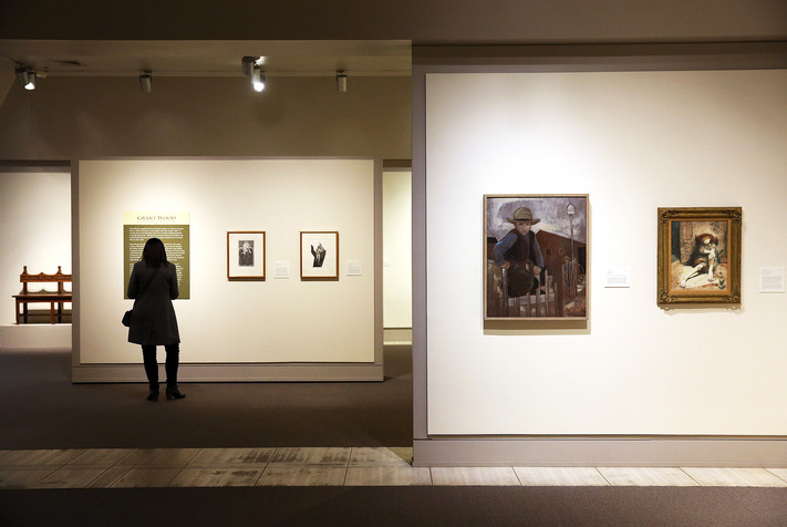 """Amish Boy"" by Zora DuVall (foreground left) and ""Boy with Salamander"" by Conger A. Metcalf are displayed at the Cedar Rapids Museum of Art in Cedar Rapids on Tuesday, Dec. 13, 2016. The first three galleries have been recently updated. (Liz Martin/The Gazette)"