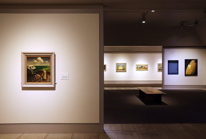 """Spring in the County"" by Grant Wood is seen in the foreground, looking into galleries exhibiting regional artists  (right) and Marvin Cone paintings (center) at the Cedar Rapids Museum of Art in Cedar Rapids on Tuesday, Dec. 13, 2016. The first three galleries have been recently updated. (Liz Martin/The Gazette)"