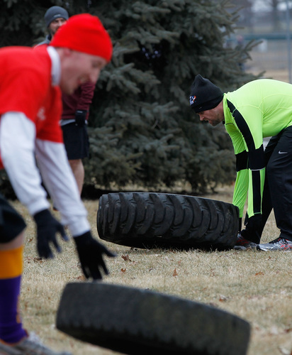 Erek Sittig of North Liberty flips tires during the Indomitable Snow Run 5K fun run at Penn Meadows Park in North Liberty on Saturday, Feb. 6, 2016. The event was part of North Liberty's Beat the Bitter Winter Games. (Adam Wesley/The Gazette)
