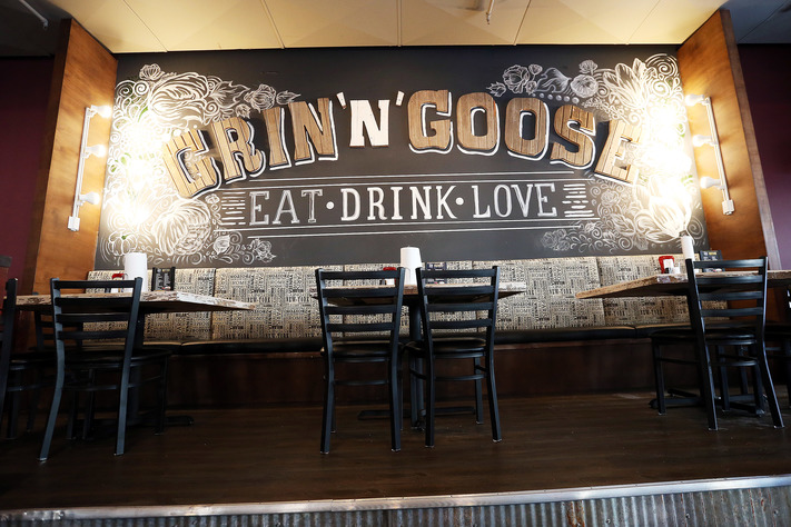 A large mural fills the wall above a raised seating area at Grin N Goose in Cedar Rapids on Wednesday, Feb. 8, 2017. (Liz Martin/The Gazette)