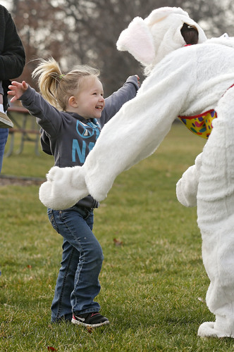 Ava King, 3, of Carlyle, Ill. greets the Easter Bunny with a big hug during the Annual Hiawatha Easter Egg Hunt at Guthridge Park in Hiawatha on Saturday, Mar. 26, 2016. (Stephen Mally/The Gazette)