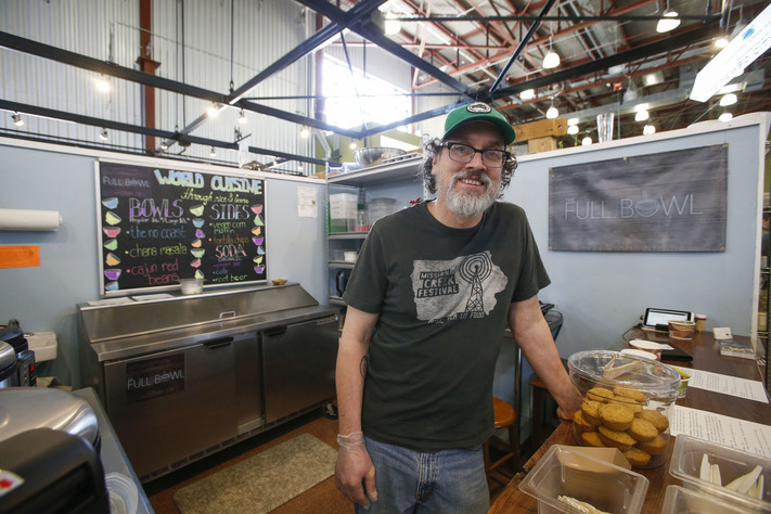 Wes Shirley is seen in his food stand at The Full Bowl in NewBo City Market in Cedar Rapids on Thursday, April 13, 2017. Shirley opened the stand, which offers vegetarian and vegan rice bowls, after identifying a need for vegetarian dining options in the city. (Rebecca F. Miller/The Gazette)
