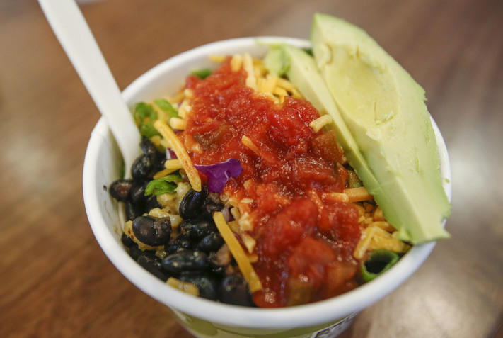 The No Coast Bowl is seen at The Full Bowl in NewBo City Market in Cedar Rapids on Thursday, April 13, 2017. Wes Shirley opened the stand, which offers vegetarian and vegan rice bowls, after identifying a need for vegetarian dining options in the city. (Rebecca F. Miller/The Gazette)