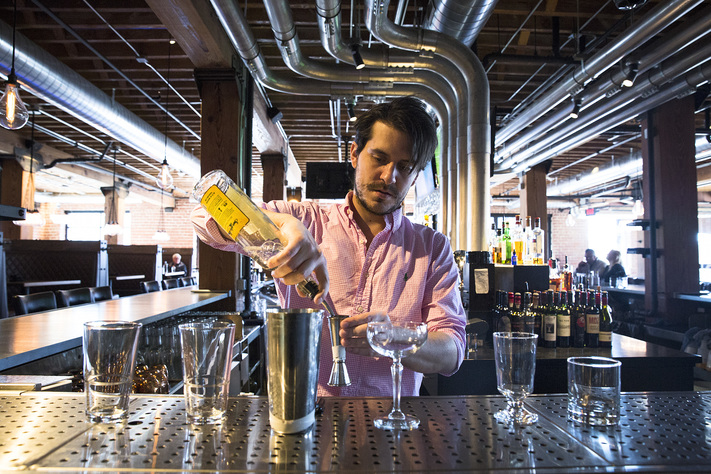 Jeff Acker, bartender at Black Sheep Social Club in Cedar Rapids, makes craft cocktails behind the bar on April 6, 2017. Bartenders at Black Sheep are contstantly experimenting with new cocktail recipes for the seasonally rotating menu. (Liz Zabel/The Gazette)