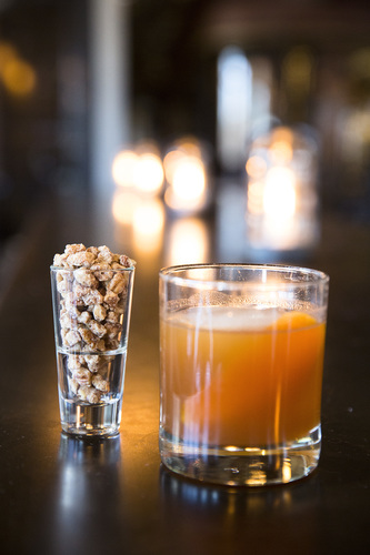 "The ""Praline Old Fashioned,"" a cocktail that took two years to create, sits on a table at Black Sheep Social Club in Cedar Rapids on April 6, 2017. The ""Praline Old Fashioned"" is a sweeter, but balanced take on the Old Fashioned that is served with praline pecans. (Liz Zabel/The Gazette)"