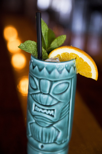 "The Pig & Porter's ""Pineapple Puaa"" sits on the restaurant's bar in Cedar Rapids on April 6, 2017. This tiki drink is made with rum, pineapple shrub, cointreau, grenadine and angostura bitters. (Liz Zabel/The Gazette)"