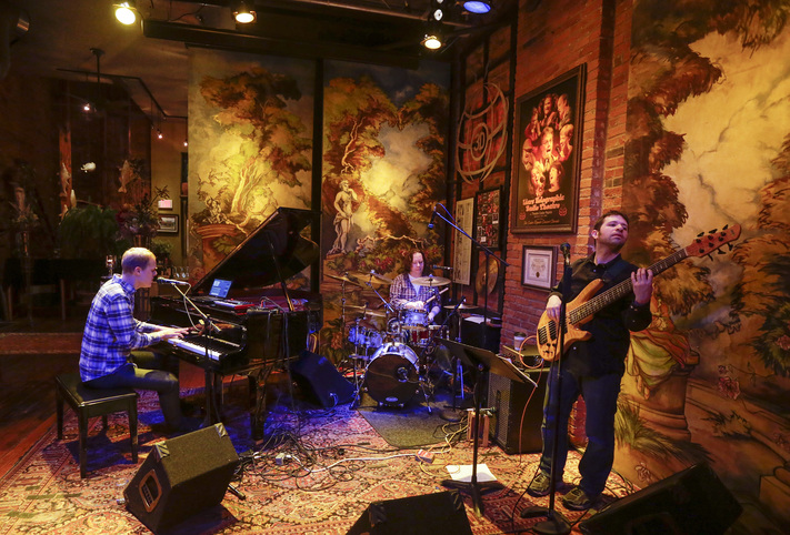 Bill Peterson (left) is The White Tornado as he performs with bass guitarist Ben Soltau (right) and drummer Chris Wood at Campbell Steele Gallery, in Marion, Iowa, on Thursday, Dec. 18, 2014. (Jim Slosiarek/The Gazette)