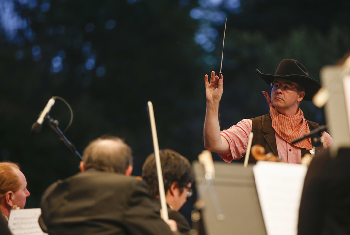Orchestra Iowa Conductor Tim Hankewich leads the symphony at Brucemore Mansion in Cedar Rapids on Saturday, Sept. 17, 2016. People brought picnics and lawn chairs and sat on the Brucemore lawn for a music program honoring Grant Wood. (Rebecca F. Miller/The Gazette)