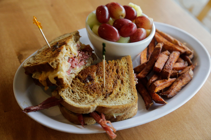 A reuben with sweet potato fries and a fruit cup at the newest Hamburg Inn #2 location, 2221 Rochester Avenue, in Iowa City, Iowa, on Friday, Oct. 6, 2017. (Jim Slosiarek/The Gazette)