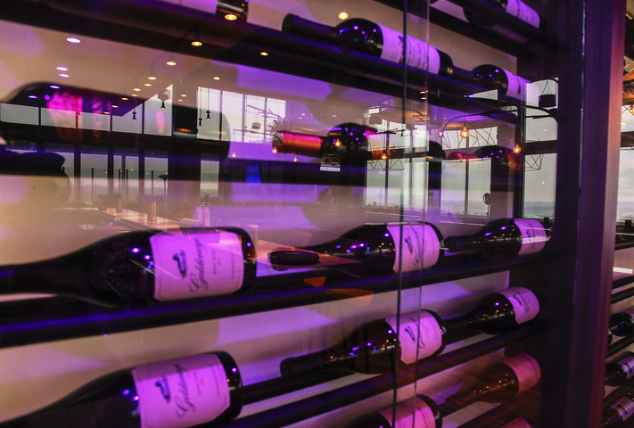Bottles of wine are seen in a decorative wine rack at Vue Rooftop, the rooftop restaurant and bar in the new Hilton Garden Inn, 328 S. Clinton St. in Iowa City, Iowa. Photographed Monday, Nov. 13, 2017. (Jim Slosiarek/The Gazette)