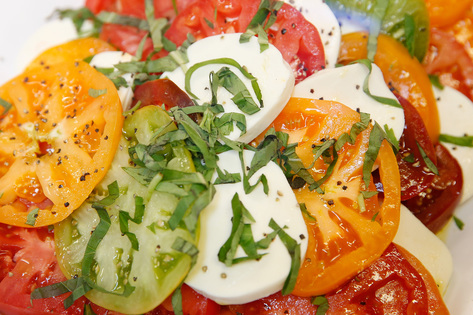 An heirloom tomato salad is shown at the deli in Lucky's Market in Iowa City on Wednesday, July 1, 2015. (Adam Wesley/The Gazette)
