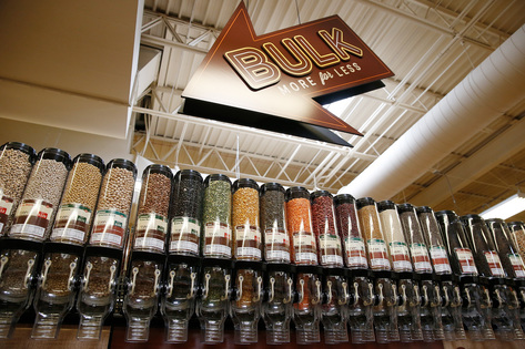 An aisle of bulk grains is shown at Lucky's Market in Iowa City on Wednesday, July 1, 2015. (Adam Wesley/The Gazette)