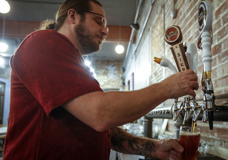 Bartender Brian Dobler pours a beer for a patron at Quarter Barrel in Cedar Rapids on Friday, Jan. 8, 2016. Quarter Barrel had an earlier soft opening to get things ready for the grand opening on January 31st. The brewery and arcade plans to serve mainly pizza as well as a variety of appetizers to go with a selection of house brews. (Andy Abeyta/The Gazette)
