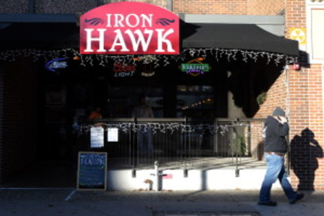 A Pedesstrain pass the Iron Hawk bar in Iowa City on Friday, November 23, 2012. (Kyle Grillot/The Gazette-KCRG)